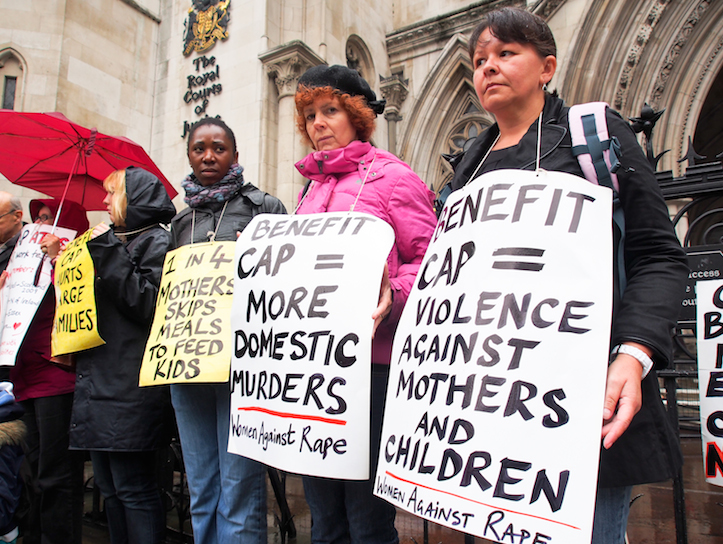 WinVisible and Single Mothers' Self-Defence gather outside the High Court with their placards.